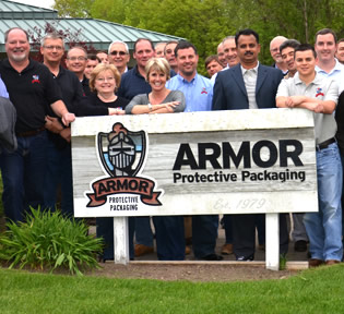 employees in front of Armor sign