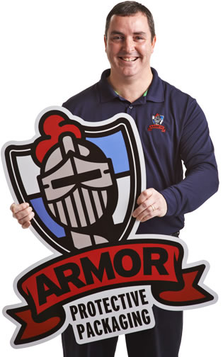 Person holding sign with Armor logo