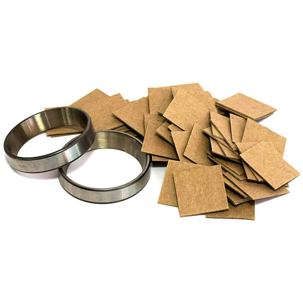 ARMOR SHIELD Chipboards piled next to metal rings