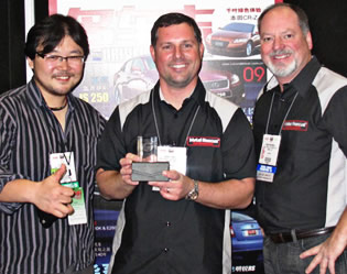 Three Armor employees with award