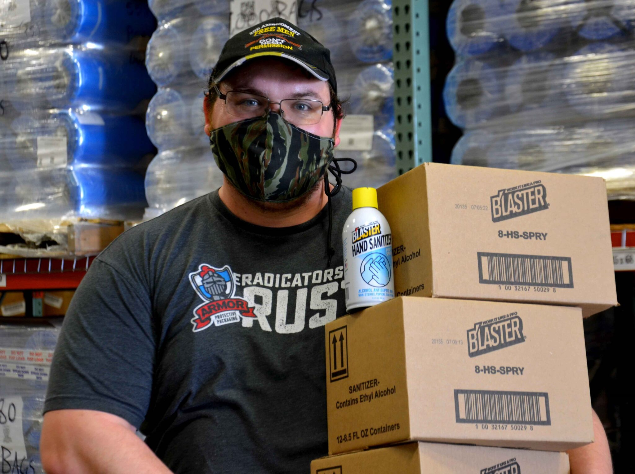 ARMOR Employee with Hand Sanitizer
