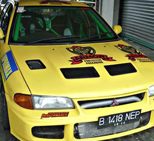 Yellow car with Armor logo