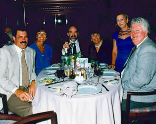 Old photo of group at dinner table