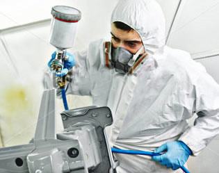 Man painting metal piece
