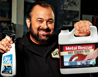 Frank Fritz holding Metal Rescue and Dry Coat
